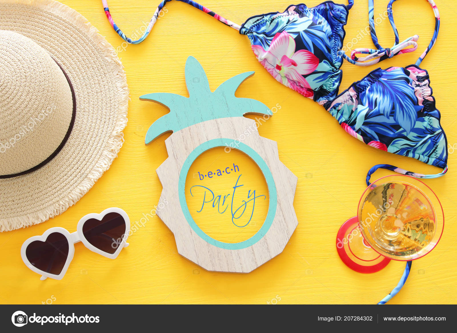 aa232e623c Top view of fashion female swimsuit bikini and white fedora hat over yellow wooden  background. Summer beach vacation concept — Photo by tomert