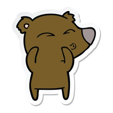 sticker of a cartoon whistling bear