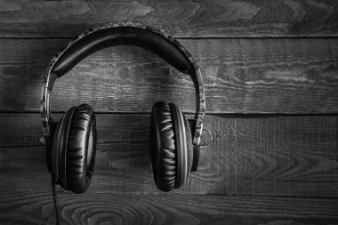 studio headphones on a dark wooden background