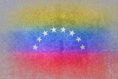 Venezuela flag on concrete wall. Grunge background.