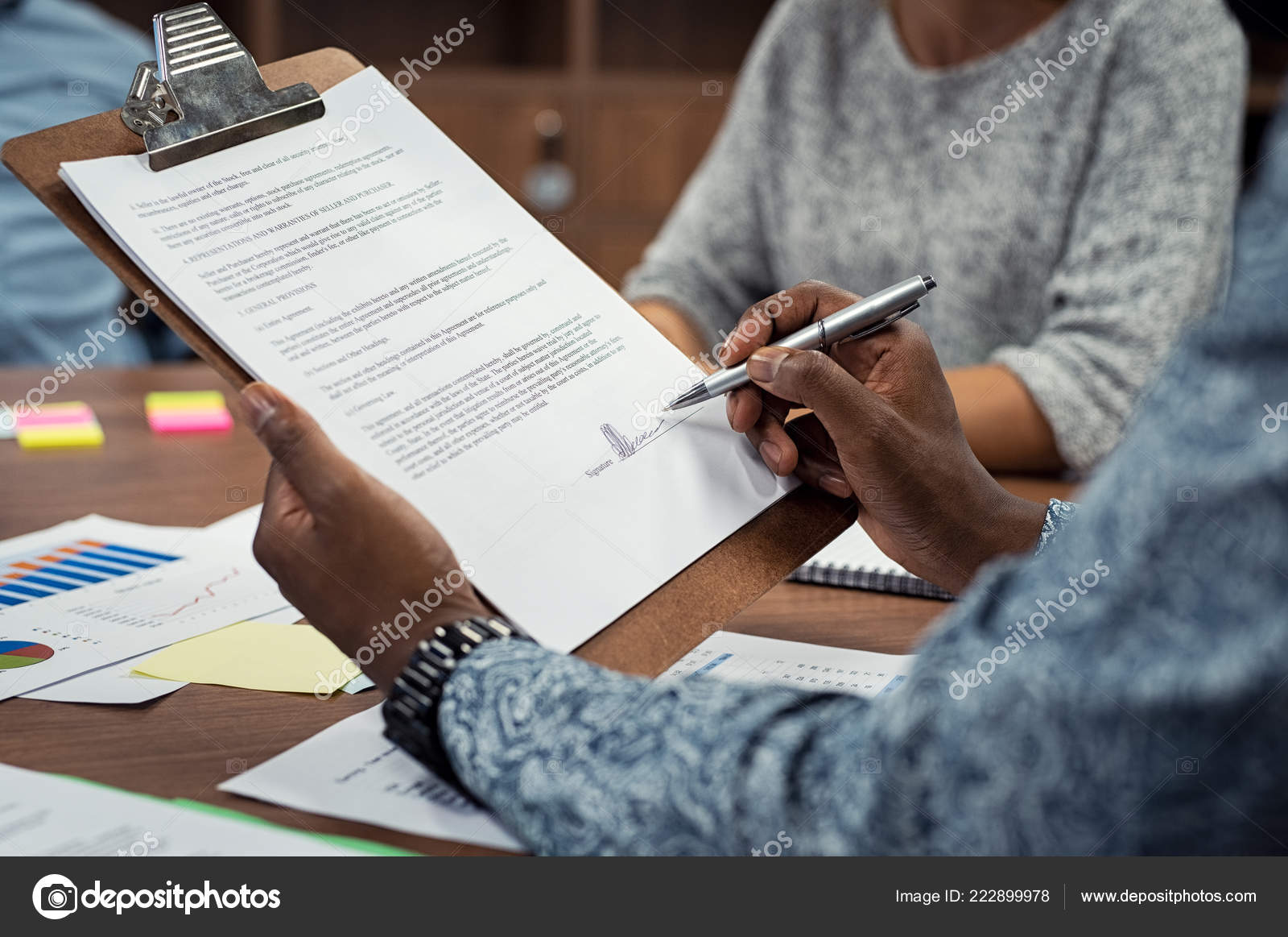 Closeup African American Businessman Signing Contract