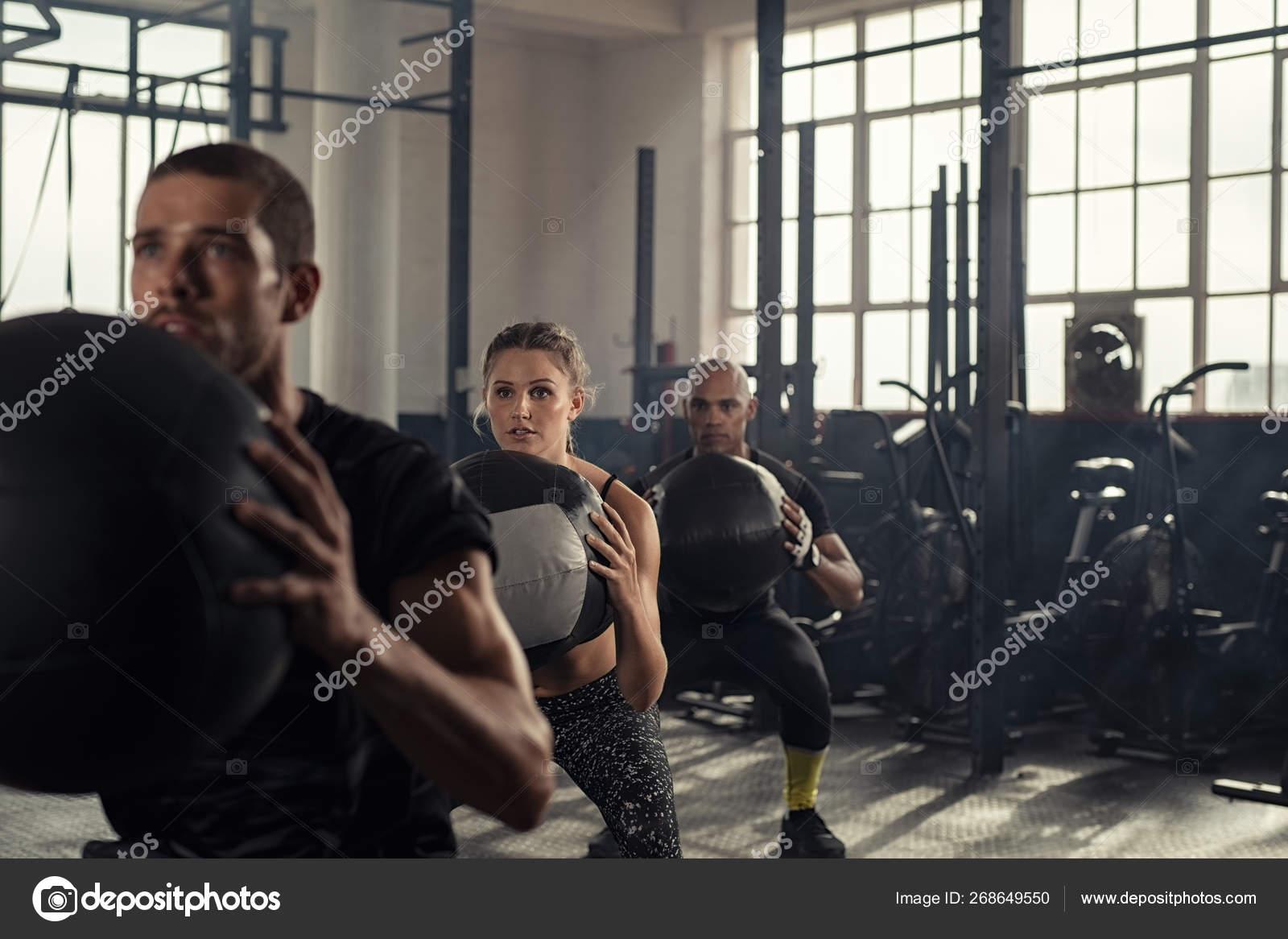 Fitness class using heavy weight balls — Stock Photo © ridofranz