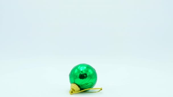 Christmas green shiny ball with golden handle rotating on white  Footage  ready for loop