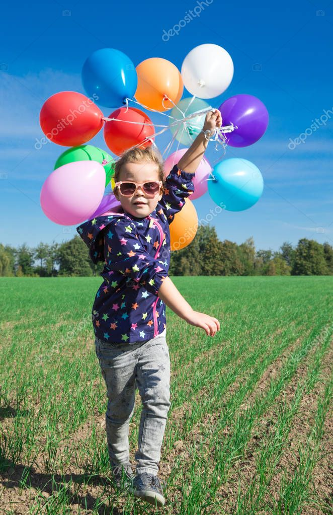 Little girl playing with balloons