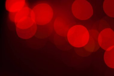 Abstract blurred dark red background with beautiful bokeh effect.