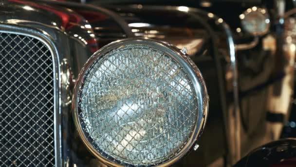 Close-up view of black vintage car headlight
