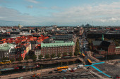 High angle view of buildings and road in Copenhagen city with cloudy sky at background, Denmark