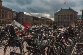 Selective focus of bicycles with sunlight on urban street in Copenhagen, Denmark
