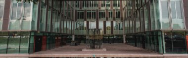 Panoramic shot of glass facade of building in Copenhagen, Denmark stock vector