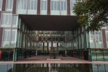 Glass facade of building near canal in Copenhagen, Denmark stock vector