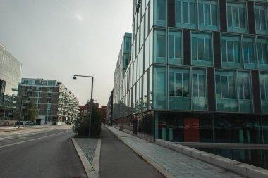 Urban street with walkway, buildings and sky at background in Copenhagen, Denmark stock vector