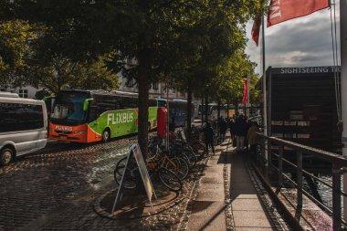 COPENHAGEN, DENMARK - APRIL 30, 2020: Bicycles near trees and road on urban street stock vector