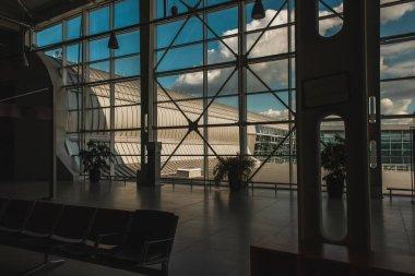 Facade of airport with cloudy sky at background in Copenhagen, Denmark stock vector
