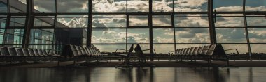 Panoramic crop of chairs in waiting hall of airport of Copenhagen, Denmark stock vector