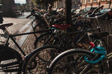 Selective focus of bicycles on walkway on urban street in Copenhagen, Denmark stock vector
