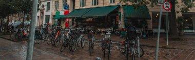 Panoramic crop of row of bicycles on urban street in Copenhagen, Denmark stock vector
