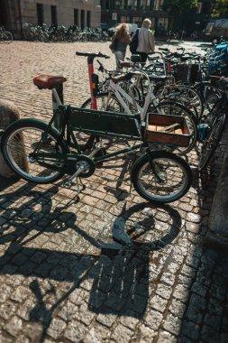 Bicycles on paving stone walkway on urban street of Copenhagen, Denmark stock vector