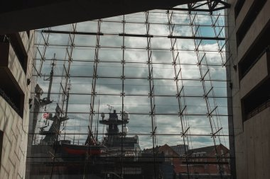 COPENHAGEN, DENMARK - APRIL 30, 2020: View from Black Diamond Royal Library on ship and cloudy sky at background, Copenhagen, Denmark stock vector