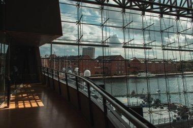 COPENHAGEN, DENMARK - APRIL 30, 2020: Glass facade of Black Diamond Royal Library with ship in harbor at background, Copenhagen, Denmark stock vector
