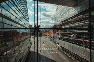 COPENHAGEN, DENMARK - APRIL 30, 2020: Exterior of Black Diamond Royal Library with urban street and cloudy sky at background, Copenhagen, Denmark stock vector
