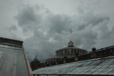 Facade of University of Copenhagen Botanical Garden with cloudy sky at background, Denmark stock vector