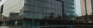 Panoramic shot of building with glass facade near canal on urban street in Copenhagen, Denmark stock vector