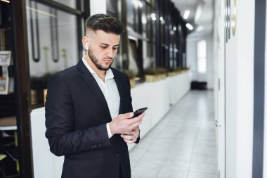 businessman using smartphone at modern office, selective focus