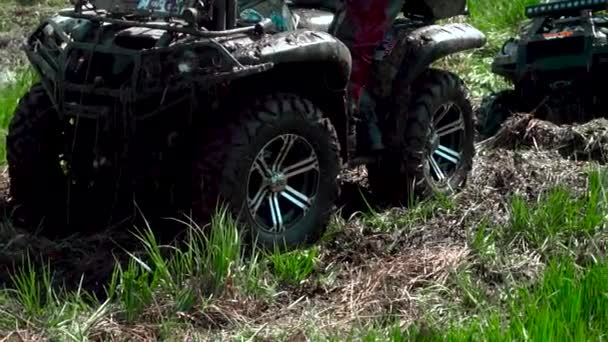 team race through the swamp on an ATV