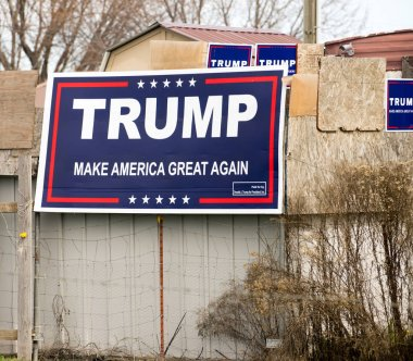 A rural property has campaign signs all over promoting Trump the presidential candidate