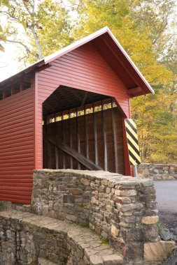 The Red Roddy River Covered Bridge allows passage over the river by the same name in Maryland