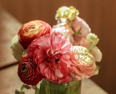 Pretty bouquet of colorful ranunculus at day