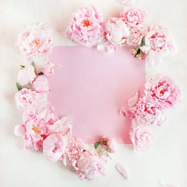 Flat lay concept with beautiful peonies, can be used as background