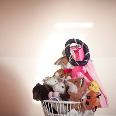 adorable small doll carriage with many stuffed animals in the princess room.