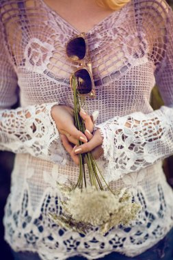 Women hands holding flowers outdoors, lust for life, summerly, autumn mood, boho style