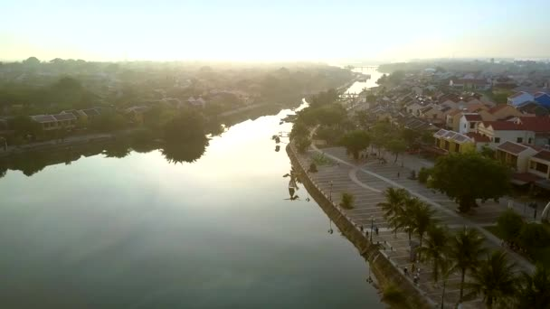 amazing aerial motion from river bank with old district to opposite with large square in Hoi An