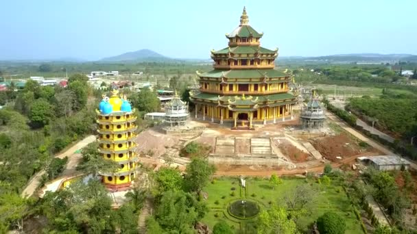 amazing aerial panorama multi-storey pagoda with colourful domes by huge building temple among green landscape