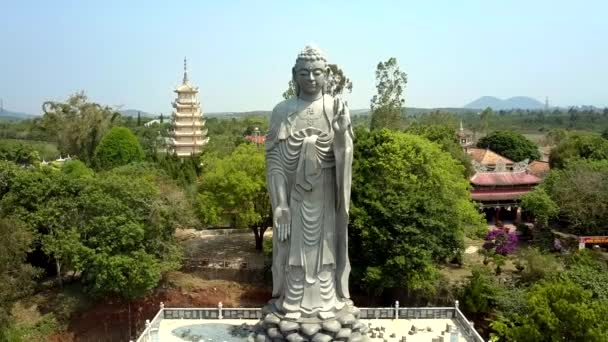 amazing aerial panorama giant Buddha grey statue among tropical park against pictorial landscape