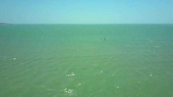 amazing aerial panorama windsurfers train among everlasting azure ocean against blue sky