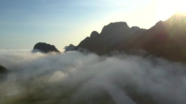 incredible aerial view calm river under morning foggy clouds against hills and endless sky before sunrise