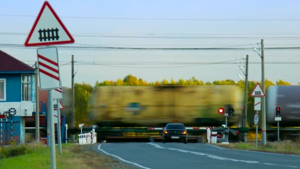 freight tanks train moves by railroad crossing at forest