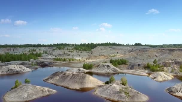 smoothed stone islets scattered on clay quarry lake