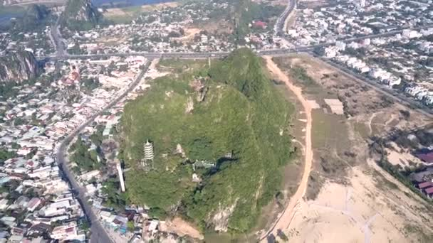 panorama hill with ancient temple among modern city