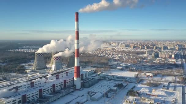 upper view winter heating station with towers and town