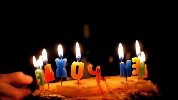 slow motion backside view birthday cake letters with candles