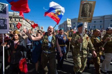 ST. PETERSBURG, RUSSIA - MAY 9, 2018: During Immortal Regiment march in the Victory Day celebrations, marking the 73rd anniversary of the victory over Nazi Germany in World War Two.
