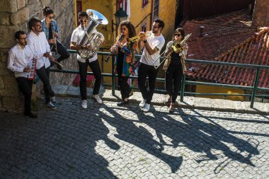 Jazz band, a group of musicians play music in the Old downtown of Porto, Portugal.