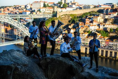 Jazz band, a group of musicians play music in front of Douro river at downtown of Porto, Portugal.