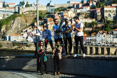 Group of musicians (Jazz band) play music in the street of old Porto downtown, Portugal.