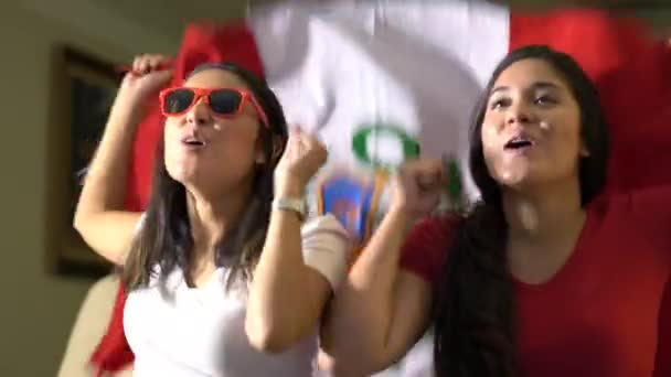 Peruvian fan celebrating during game at home