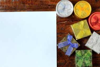 Christmas composition. Christmas gifts on wooden table. Top view, empty space, paper, cardboard